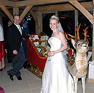 Giles and Amelia with Christmas Reindeer, Wedding at Gaynes Park, Epping, Essex
