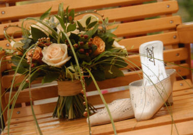 Wedding Bouquet created by Essex Florist displayed with Bridal Shoes